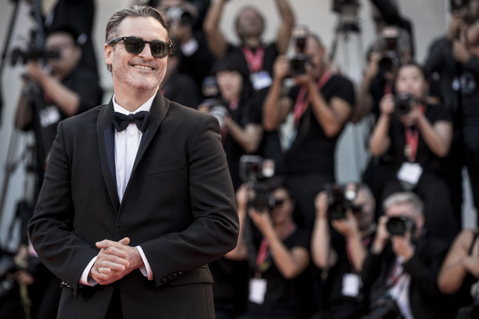 """VENICE, ITALY - AUGUST 31: Joaquin Phoenix walks the red carpet ahead of the """"Joker"""" screening during the 76th Venice Film Festival at Sala Grande on August 31, 2019 in Venice, Italy. (Photo by Alessandra Benedetti - Corbis/Corbis via Getty Images)"""