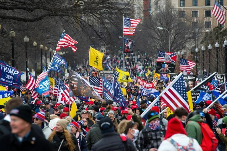 Thousands of supporters of US President Donald Trump march through the streets of Washington en route to the Capitol on January 6, 2021, ahead of the attack on the building