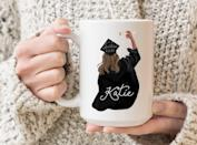 <p>They will love using this <span>Custom Graduation Mug</span> ($14, and up) to commemorate their big achievement!</p>