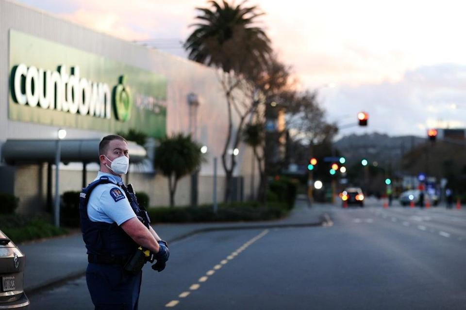 Police guard the area around Countdown LynnMall after the attack (Getty)