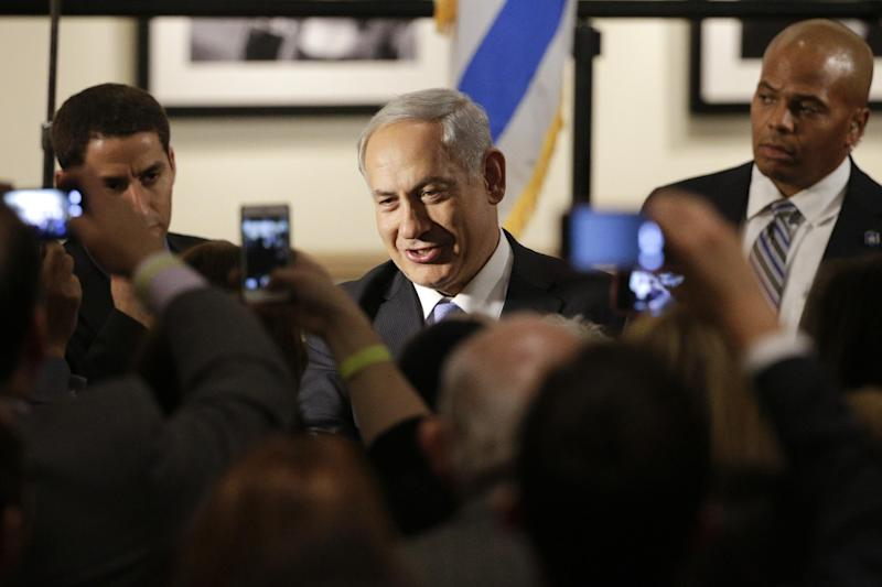 """Israeli Prime Minister Benjamin Netanyahu, center, shakes hands with supporters before the screening of the television documentary """"Israel: The Royal Tour"""" at Paramount Studios on Tuesday, March 4, 2014, in Los Angeles. Netanyahu flew Tuesday from Washington, D.C., to California, trading a focus on the geopolitics of the Middle East for a Hollywood screening and visits with Silicon Valley tech entrepreneurs. (AP Photo/Jae C. Hong)"""