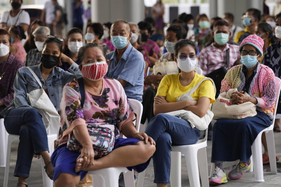 Residents wait to receives shots of the AstraZeneca COVID-19 vaccine at the Central Vaccination Center in Bangkok, Thailand, Thursday, July 15, 2021. As many Asian countries battle against a new surge of coronavirus infections, for many their first, the slow-flow of vaccine doses from around the world is finally picking up speed, giving hope that low inoculation rates can increase rapidly and help blunt the effect of the rapidly-spreading delta variant. (AP Photo/Sakchai Lalit)