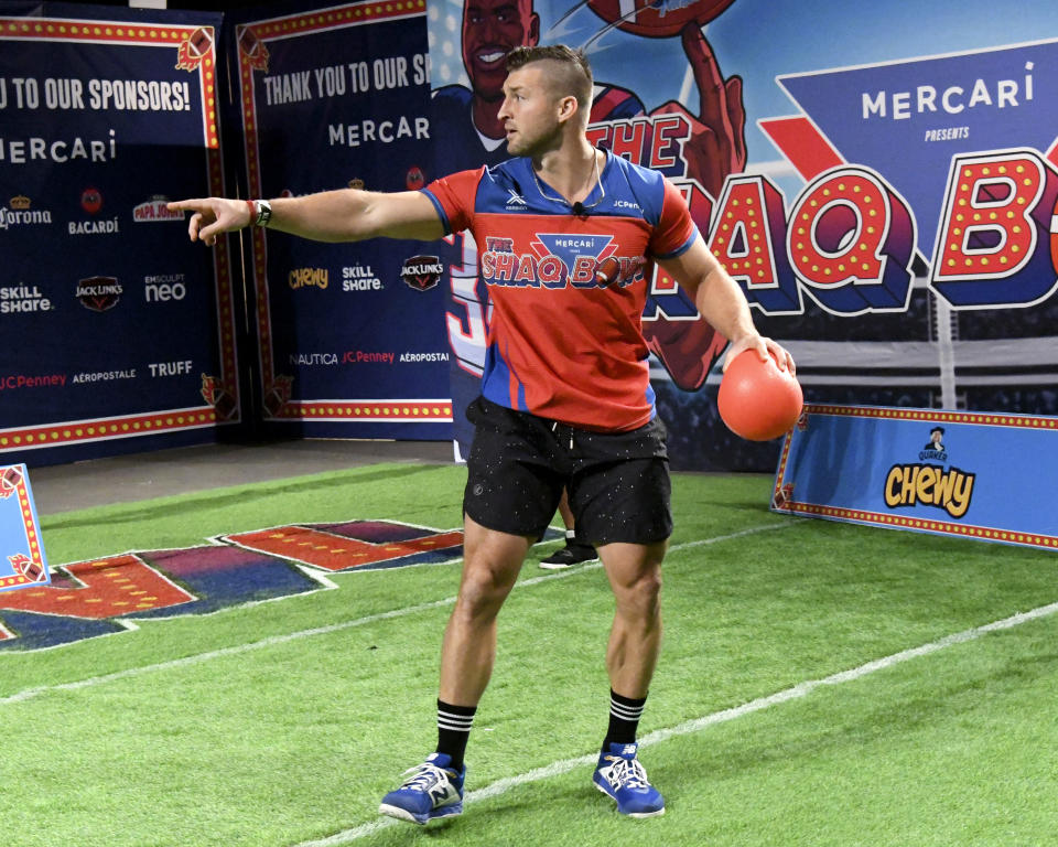 TAMPA, FLORIDA - FEBRUARY 07: Tim Tebow participates in a celebrity challenge at The SHAQ Bowl for Super Bowl LV on February 07, 2021 in Tampa, Florida. (Photo by Gerardo Mora/Getty Images)