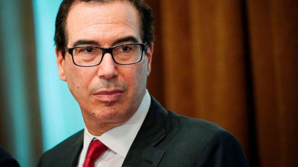 PHOTO: Treasury Secretary Steven Mnuchin watches as President Donald Trump speaks during a meeting with Republican members of Congress and Cabinet members in the Cabinet Room of the White House, June 20, 2018. (Mandel Ngan/AFP/Getty Images)
