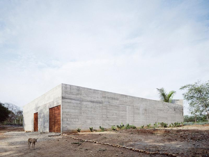 From the outside, the Zicatela House looks like little more than an unforgiving concrete bunker.