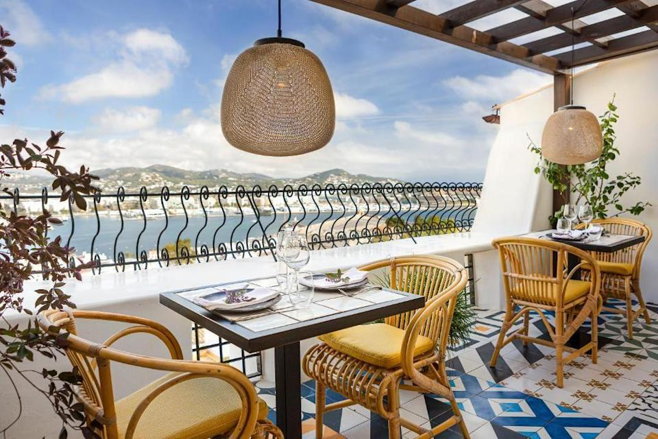 """<p>Promising a privileged panorama of both Dalt Vila and the Mediterranean, this chichi boutique hotel steeped in history and charm is well-placed for exploring Ibiza Town's more cultural offerings – aka the hole-in-the-wall bars and late-night tavernas of Old Town Ibiza.</p><p>Rooms have a warm and rustic Spanish appeal – think colourful tiled floors, natural woods and rattan furnishings, while suites have private terraces with views of the bay or the old town. Making the most of its elevated position, the highlight of <a href=""""https://www.booking.com/hotel/es/la-torre-del-canonigo.en-gb.html?aid=2070929&label=ibiza-hotels"""" rel=""""nofollow noopener"""" target=""""_blank"""" data-ylk=""""slk:La Torre del Canónigo"""" class=""""link rapid-noclick-resp"""">La Torre del Canónigo</a> is its brace of terraces, where you'll find a small pool shaded by olive trees and an oh-so romantic Mediterranean restaurant with a twinkling appeal, and both with views across the Med.</p><p><a class=""""link rapid-noclick-resp"""" href=""""https://www.booking.com/hotel/es/la-torre-del-canonigo.en-gb.html?aid=2070929&label=ibiza-hotels"""" rel=""""nofollow noopener"""" target=""""_blank"""" data-ylk=""""slk:CHECK AVAILABILITY"""">CHECK AVAILABILITY</a></p>"""
