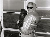 """<p>When Hollywood actress Grace Kelly embarked across the Atlantic to marry Prince Rainier of Monaco, she didn't go alone. The actress had a furry friend by her side on the voyage: her Poodle, Oliver. Kelly was given the dog by her dear friend and <a href=""""https://nationalpurebreddogday.com/grace-kellys-wedding-dogs/"""" rel=""""nofollow noopener"""" target=""""_blank"""" data-ylk=""""slk:costar Cary Grant"""" class=""""link rapid-noclick-resp"""">costar Cary Grant</a>.</p>"""