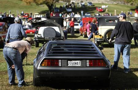 Admirers inspect a 1981 DeLorean DMC-12 at the annual Rockville Maryland Antique and Classic Car Show