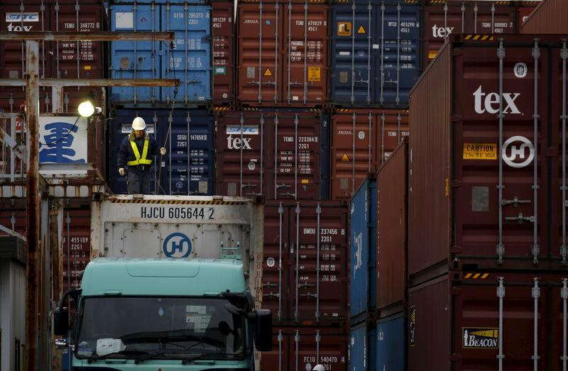 A laborer works in a container area at a port in Tokyo