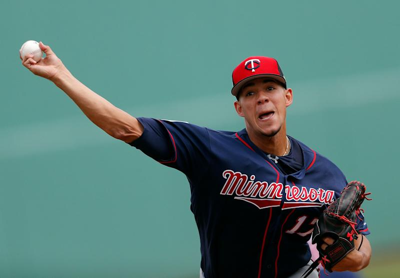 Minnesota Twins starting pitcher Jose Berrios (17) warms up before the first inning of a spring training baseball game against the Boston Red Sox Wednesday, March 13, 2019, in Fort Myers, Fla. (AP Photo/John Bazemore)