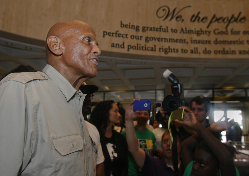 American singer, songwriter, actor and social activist Harry Belafonte, Jr. speaks to Dream Defenders Friday, July 26, 2013 in the Capitol rotunda in Tallahassee, Fla. Dream Defenders were joined by Belafonte, Jr. as they went into their 11th day of a sit-in of Florida Gov. Rick Scott's office. The sit-in is their response to the 'not guilty' verdict in the trial of George Zimmerman, the Florida neighborhood watch volunteer who fatally shot Trayvon Martin. They are continuing to demand Scott call a special session. (AP Photo/Phil Sears)