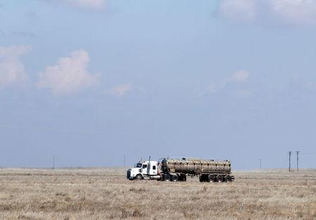 FILE PHOTO: A tanker truck used to haul oil products drives away from an oil facility near Brooks