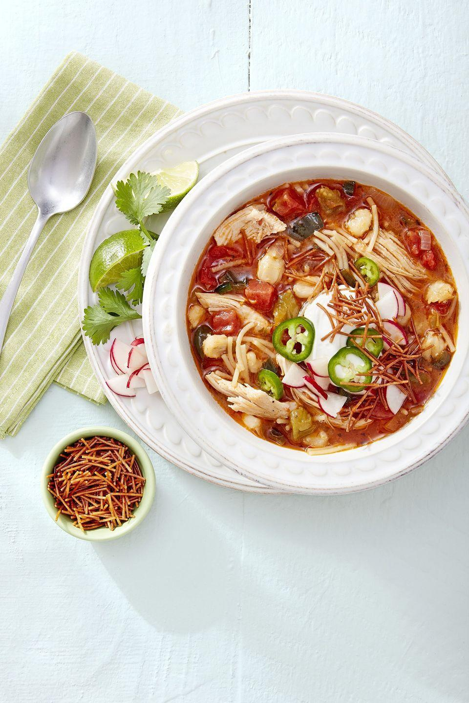 """<p>Sometimes you have to stick to tradition — and this posole is the crème de la crème.</p><p><a href=""""https://www.countryliving.com/food-drinks/a16571302/chicken-and-fideo-posole-recipe/"""" rel=""""nofollow noopener"""" target=""""_blank"""" data-ylk=""""slk:Get the recipe from Country Living »"""" class=""""link rapid-noclick-resp""""><em>Get the recipe from Country Living »</em></a></p><p><strong>RELATED: </strong><a href=""""https://www.goodhousekeeping.com/food-recipes/easy/g26102687/instant-pot-soups/"""" rel=""""nofollow noopener"""" target=""""_blank"""" data-ylk=""""slk:20 Instant Pot Soups That Are Basically Comfort in a Bowl"""" class=""""link rapid-noclick-resp"""">20 Instant Pot Soups That Are Basically Comfort in a Bowl</a><br></p>"""