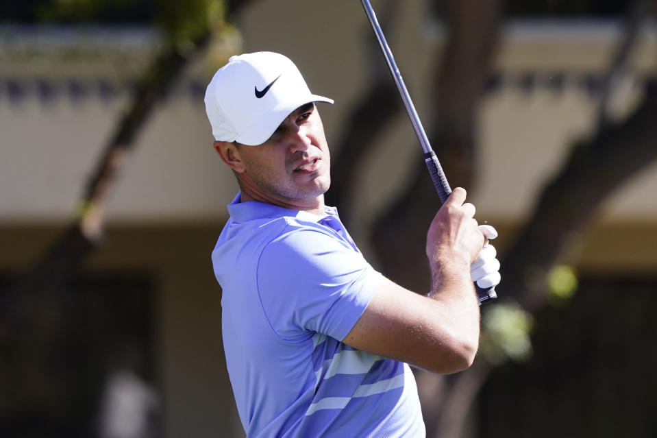 Brooks Koepka tees off on the fifth hole during the final round of a PGA golf tournament on Sunday, Feb. 7, 2021, in Scottsdale, Ariz. (AP Photo/Rick Scuteri)