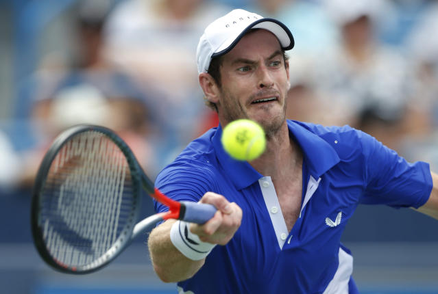 Andy Murray, of Britain, hits a forehand against Richard Gasquet, of France, during first-round play at the Western & Southern Open tennis tournament Monday, Aug. 12, 2019, in Mason, Ohio. (AP Photo/Gary Landers)