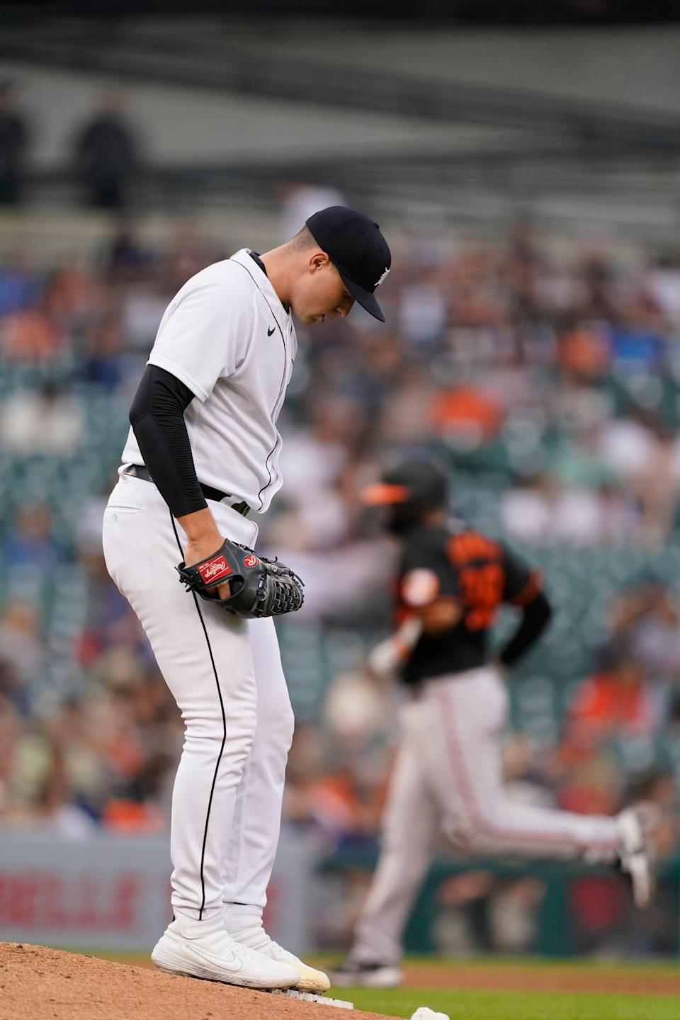 Detroit Tigers starting pitcher Tarek Scopal standing on a hill like the Baltimore Orioles Pedro Severino spins the rules following a singles run at home during the fifth inning of a baseball game, Friday, July 30, 2021, in Detroit.