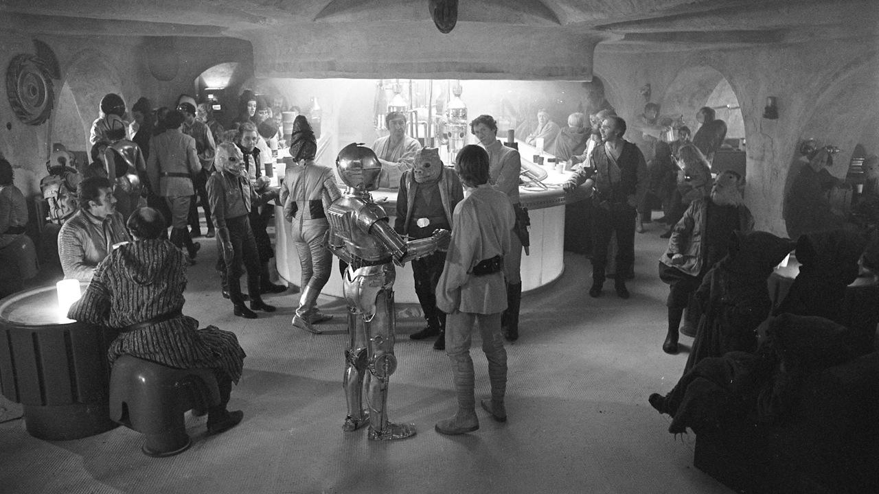 "<p>A wide shot of <a rel=""nofollow"" href=""https://www.yahoo.com/movies/the-star-wars-cantina-scene-the-151216488.html"">the original cantina set</a>, with C-3PO and Luke Skywalker in the foreground. (Image: Lucasfilm via Nick Maley)</p>"