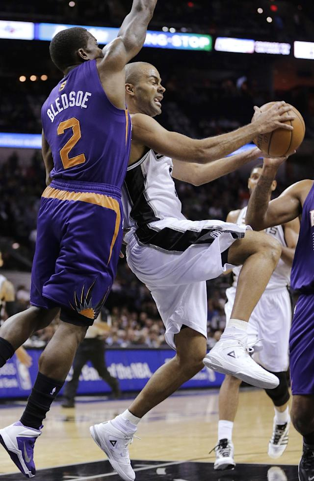 San Antonio Spurs' Tony Parker, right, of France, is pressured by Phoenix Suns' Eric Bledsoe (2) during the first half of an NBA basketball game, Wednesday, Nov. 6, 2013, in San Antonio. (AP Photo/Eric Gay)