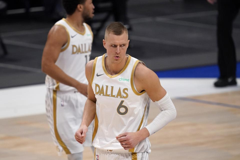 Dallas Mavericks' Kristaps Porzingis (6) celebrates after sinking a three-point basket in the second half of an NBA basketball game against the New Orleans Pelicans in Dallas, Friday, Feb. 12, 2021. (AP Photo/Tony Gutierrez)