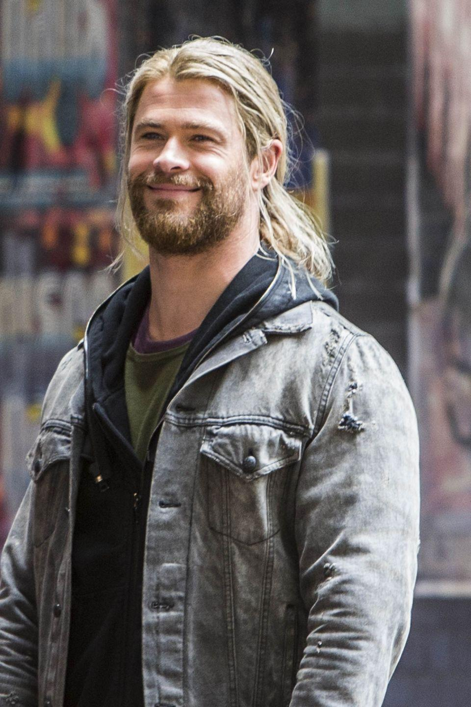 <p>Usually Chris Hemsworth wears his hair in a short cut, but while filming <em>Thor </em>the actor rocks a longer look. Based on how often the actor switches between the two hairstyles, we'd have to guess he wears extensions. Just a guess!</p>