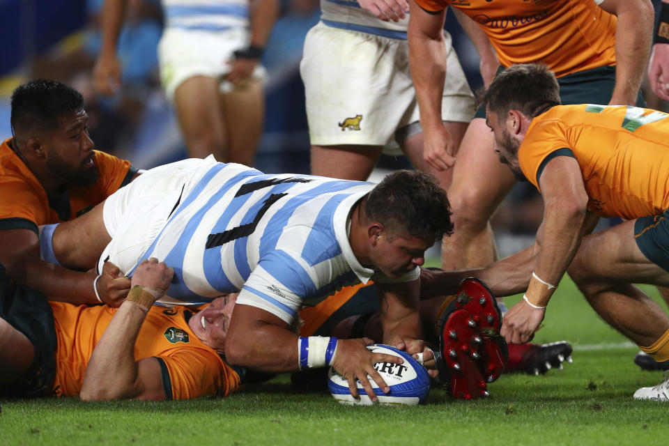 Argentina's Thomas Gallo, center, scores a try against Australia during their Rugby Championship test match on the Gold Coast, Australia, Saturday, Oct. 2, 2021. (AP Photo/Tertius Pickard)