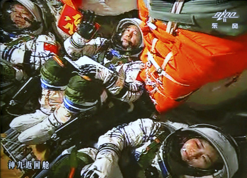FILE - In this June 16, 2012 file image made off the monitor screen at the Beijing Aerospace Flight Control Center and released by China's Xinhua News Agency, China's astronauts Jing Haipeng, center, Liu Wang, left, and Liu Yang sit inside the capsule after the launch of China's manned Shenzhou-9 spacecraft. China's astronauts have braved the tension of docking with a space station and performed delicate tasks outside their orbiting capsule, but now face a more down-to-Earth job that is perhaps equally challenging: Talking to young people about science. Coming on the heels of Canadian astronaut Chris Hadfield's wildly popular YouTube videos from the International Space Station, the three astronauts aboard China's latest mission, expected to launch early June 2013, plan to deliver a series of talks to students from aboard China's Tiangong 1 space lab.(AP Photo/Beijing Aerospace Flight Control Center via Xinhua, File) NO SALES