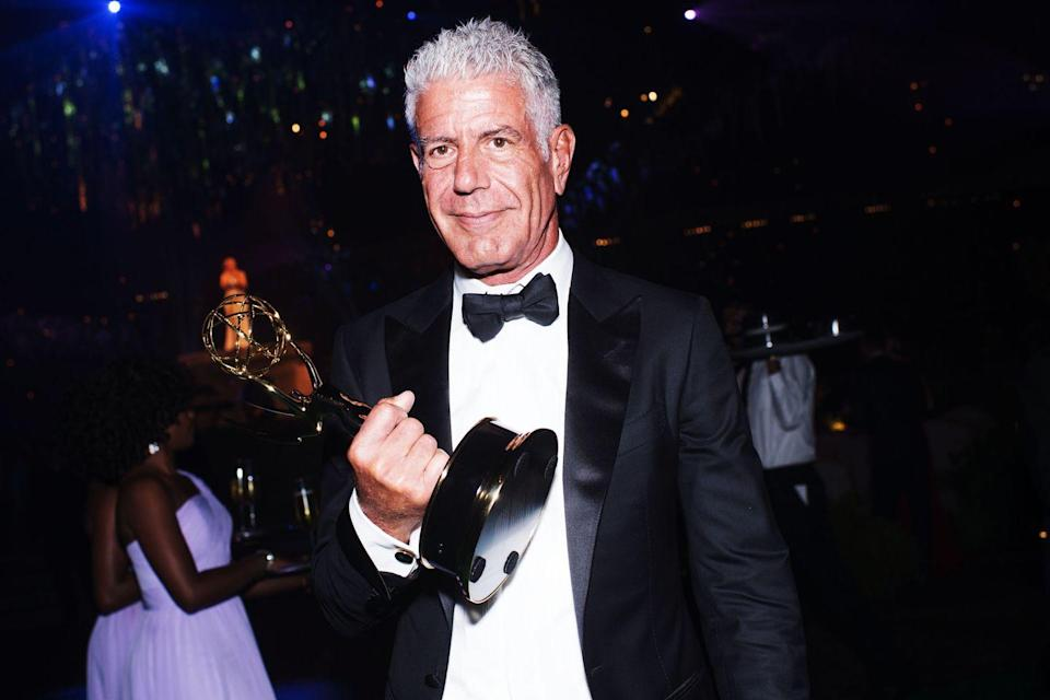 <p>Bourdain attends the Emmy Awards in L.A. on September 10, 2016, carrying an Emmy he won. </p>