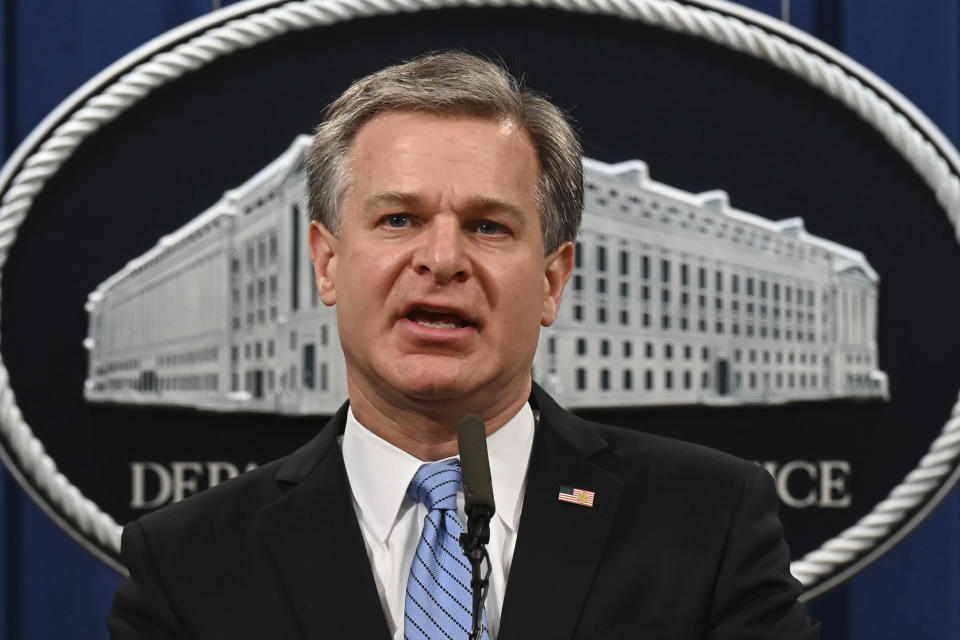 FBI Director Christopher Wray speaks during a press conference at the Department of Justice, Wednesday, Oct. 7, 2020, in Washington. The Justice Department is announcing charges against two men from Britain who joined the Islamic State and were part of a cell that beheaded Western hostages. (Jim Watson via AP)