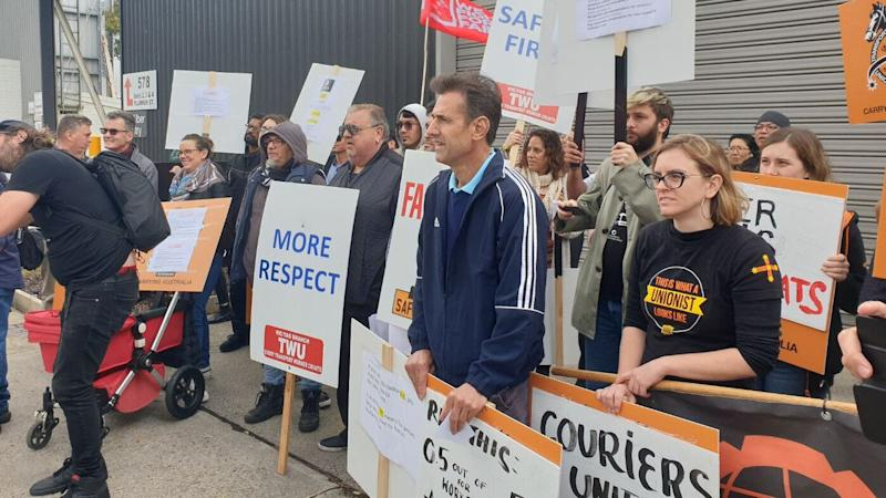 TWU and rideshare drivers protest in front of Uber's Melbourne office. (Image: supplied)