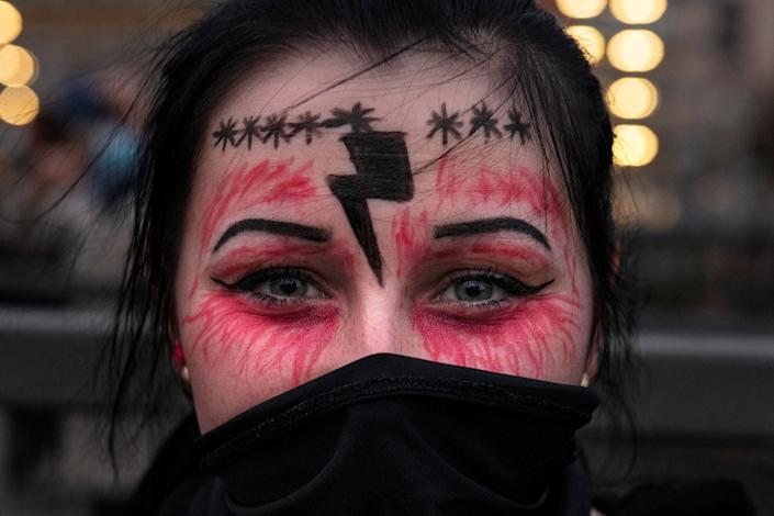 Image: A woman participates in a protest against the Polish Constitutional Court's ruling imposing an almost complete ban on abortion, in Gdansk (Jadwiga Figula / Reuters)