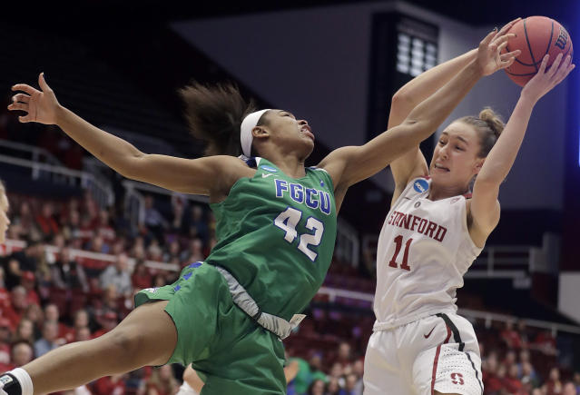 Stanford forward Alanna Smith (11) grabs a rebound against Florida Gulf Coast guard Tytionia Adderly (42) during the first half of a second-round game in the NCAA women's college basketball tournament in Stanford, Calif., Monday, March 19, 2018. (AP Photo/Jeff Chiu)