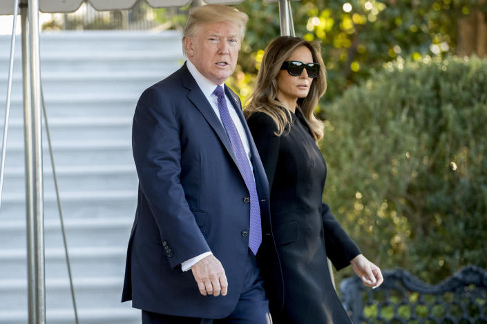 <p>President Donald Trump and first lady Melania Trump walk toward Marine One on the South Lawn of the White House in Washington, Wednesday, Oct. 4, 2017, for a short trip to Andrews Air Force Base, Md., and then on to Las Vegas to visit with victims and first responders affected by the worst mass shooting in American history. (Photo: Andrew Harnik/AP) </p>