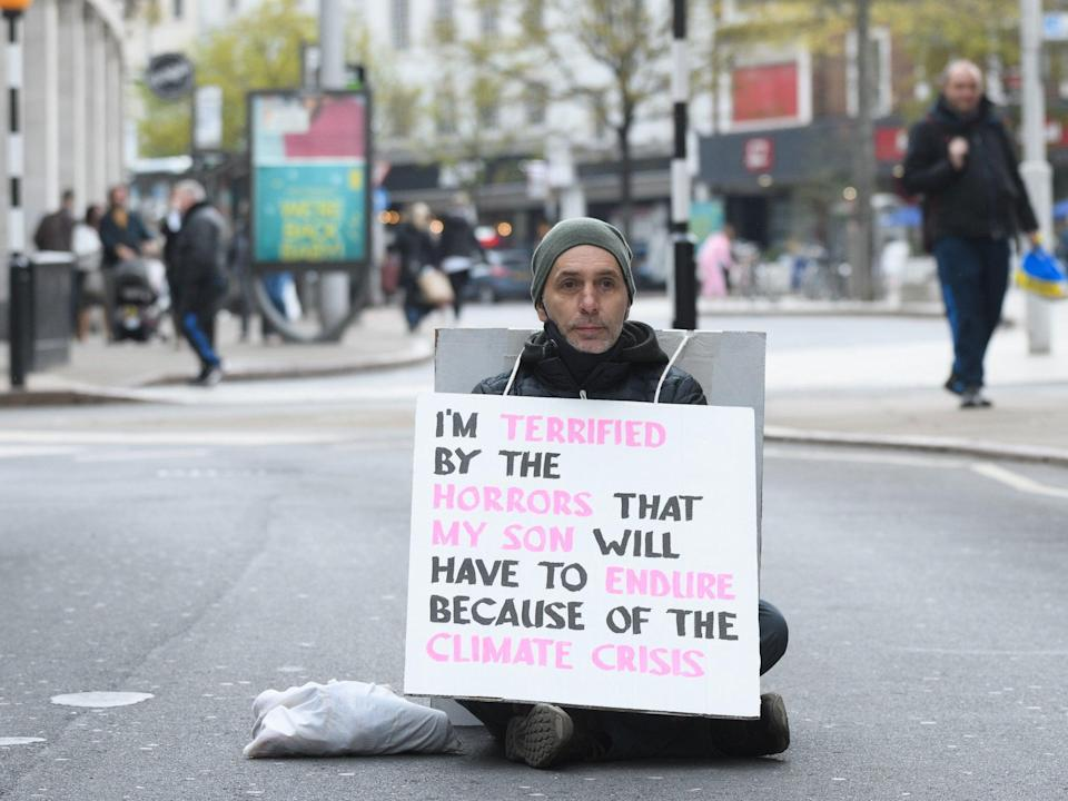 """A protester blocks traffic in Nottingham as part of the """"Rebellion of One"""" day of actionPA"""