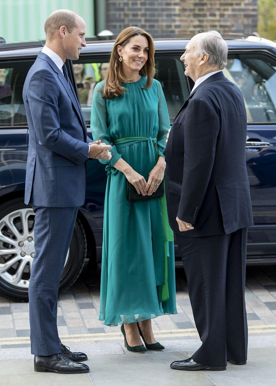 """<p>The Duchess of Cambridge stepped out for a meeting with Prince Shah Karim Al Hussaini, Aga Khan IV at the Aga Khan Centre wearing dark <a href=""""https://www.net-a-porter.com/us/en/product/1114994/aross_girl_x_soler/amanda-silk-georgette-maxi-dress?"""" rel=""""nofollow noopener"""" target=""""_blank"""" data-ylk=""""slk:green dress by ARoss Girl x Soler"""" class=""""link rapid-noclick-resp"""">green dress by ARoss Girl x Soler</a>. Kate completed the look with <a href=""""https://www.zeenwoman.com/row/wxe92033-green-dazzling-ceramic-drops"""" rel=""""nofollow noopener"""" target=""""_blank"""" data-ylk=""""slk:an affordable pair of earrings by the Pakistani designer Zeen"""" class=""""link rapid-noclick-resp"""">an affordable pair of earrings by the Pakistani designer Zeen</a>.</p>"""