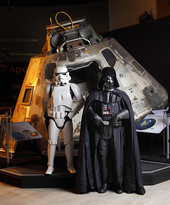 "Galdino Sanchez is a Stormtrooper and Lance Mah is Darth Vader, shown here next to the Apollo 9 capsule at the San Diego Air & Space Museum. Sanchez, whose outfit is made of ABS plastic, has been going to Comic-Con for 23 years. Mah, who has been going for two years, made his outfit from Fiberglas, wool and plastic. The two say they have no problem with Comic-Con being canceled this year as people's health and well-being outweigh everything else. <span class=""copyright"">(K.C. Alfred / The San Diego Union-Tribune)</span>"