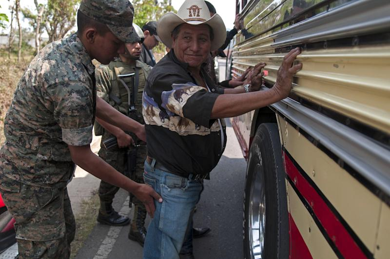 A man is checked for weapons by soldiers at a checkpoint in Mataquescuintla, Guatemala, Thursday, May 2, 2013. Guatemala's government declared a state of emergency and banned public gatherings Thursday in four townships east of the capital including Mataquescuintla, following several days of violent clashes between police and anti-mining protesters. The government sent in 500 police officers and 2,000 soldiers, some in armored personnel vehicles. It said protesters were armed with guns and explosives. Clashes have involved police, mine security guards and local protesters. (AP Photo/Luis Soto)