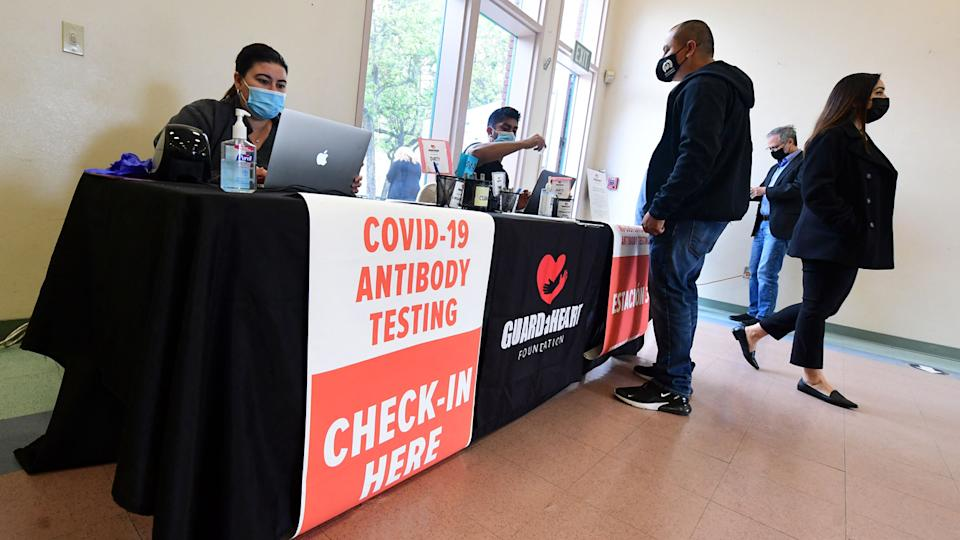 People arrive for the new FDA emergency use and authorized IgG ll Antibody Test for vaccinated people, offered free of charge in Santa Fe Springs, California, on April 21, 2021. (Frederic J. Brown/AFP via Getty Images)
