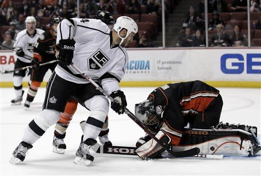 Anaheim Ducks goalie Jonas Hiller, right, stops a shot by Los Angeles Kings left wing Dwight King in the first period of an NHL hockey game in Anaheim, Calif., Friday, March 16, 2012. (AP Photo/Jae C. Hong)