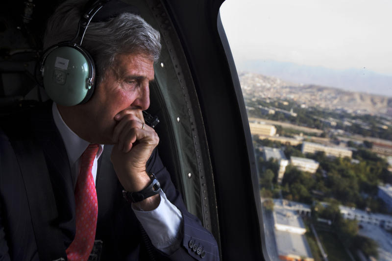 U.S. Secretary of State John Kerry looks out the window en route to the ISAF headquarters after arriving on an unannounced visit in Kabul, Afghanistan, Friday, Oct. 11, 2013. Kerry flew to Afghanistan Friday for urgent talks with Afghan President Hamid Karzai as an end of October deadline looms for completing a security deal that would allow American troops to remain in Afghanistan after the end of the NATO-led military mission next year. (AP Photo/Jacquelyn Martin, Pool)