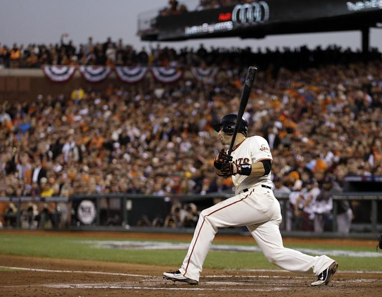 San Francisco Giants' Marco Scutaro watches his three RBI hit during the fourth inning of Game 2 of baseball's National League championship series against the St. Louis Cardinals Monday, Oct. 15, 2012, in San Francisco. (AP Photo/Ben Margot)