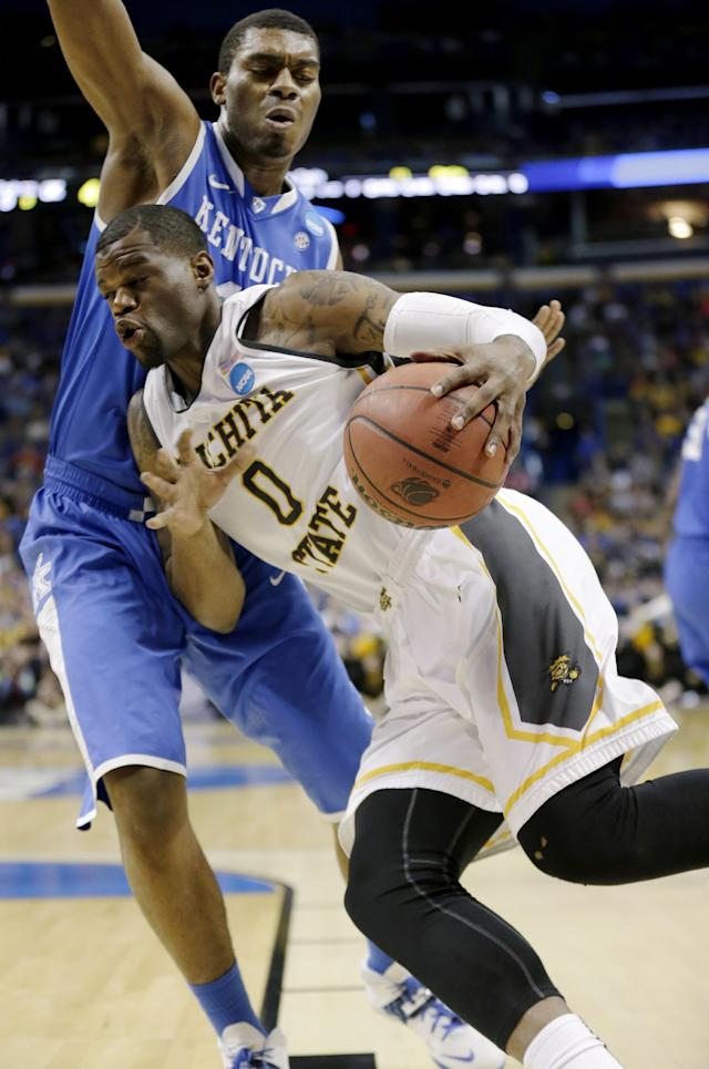 Kentucky center Dakari Johnson (44) defends against Wichita State forward Chadrack Lufile (0) during the first half of a third-round game of the NCAA college basketball tournament Sunday, March 23, 2014, in St. Louis. (AP Photo/Charlie Riedel)
