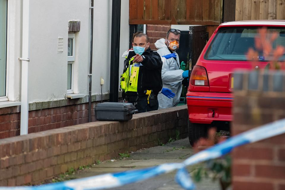 Police at the scene on Bounry Avenue, Rowely Regis, West Midlands. (SWNS)