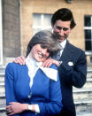 """FILE - In this Feb. 24, 1981 file photo, Britain's Prince Charles and Lady Diana Spencer pose following the announcement of their engagement. For someone who began her life in the spotlight as """"Shy Di,"""" Princess Diana became an unlikely, revolutionary during her years in the House of Windsor. She helped modernize the monarchy by making it more personal, changing the way the royal family related to people. By interacting more intimately with the public -- kneeling to the level of children, sitting on edge of a patient's hospital bed, writing personal notes to her fans -- she set an example that has been followed by other royals as the monarchy worked to become more human and remain relevant in the 21st century. (AP Photo/Ron Bell, Pool, File)"""