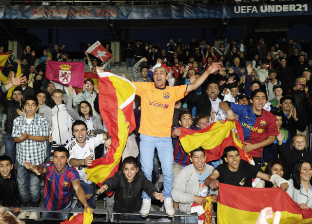 Spanish fans celebrate at the end of the UEFA Under-21 European Championship final football match Spain vs Switzerland at the Aarhus Stadium, on June 25, 2011. Spain won 2-0.AFP PHOTO/JONATHAN NACKSTRAND (Photo credit should read JONATHAN NACKSTRAND/AFP/Getty Images)