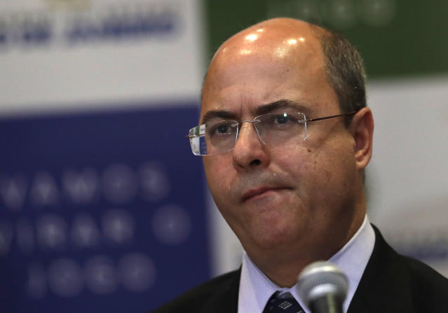 Rio de Janeiro Gov. Wilson Witzel listens to a question during a press conference concerning the death of an 8-year-old girl in Rio de Janeiro, Brazil, Monday, Sept. 23, 2019. Ágatha Sales Félix died Friday after she was shot in the back while riding in a van in the Complexo do Alemao slum. (AP Photo/Silvia Izquierdo)