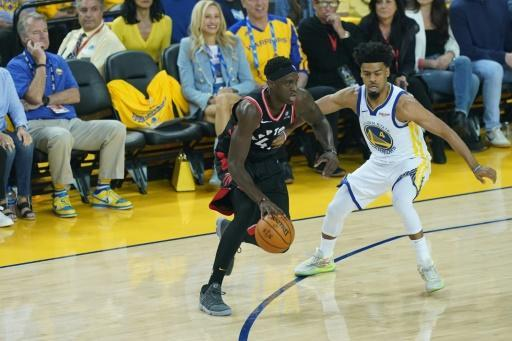 Golden State Warriors minority investor Mark Stevens, seated in blue shirt at left, was issued a one-year NBA ban and fined $500,000 after shoving Toronto's Kyle Lowry in game three of the NBA Finals