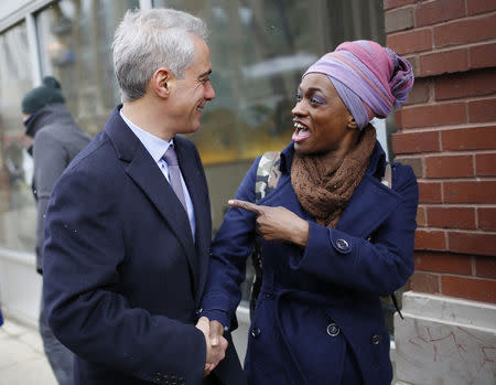 Chicago Mayor Rahm Emanuel shares a laugh with a potential voter while campaigning on election day in Chicago, Illinois, February 24, 2015. REUTERS/Jim Young