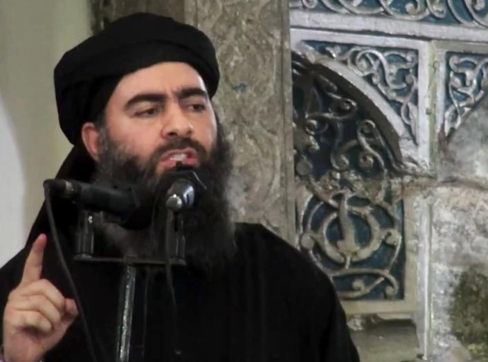 FILE - This file image made from video posted on a militant website Saturday, July 5, 2014, purports to show the leader of the Islamic State group, Abu Bakr al-Baghdadi, delivering a sermon at a mosque in Iraq during his first public appearance. The Washington-based Syria Justice and Accountability Center, a U.S.-based Syrian rights group, said Thursday, Jan. 16, 2020, that evidence, documents produced by the Islamic State militants themselves, could help identify individuals responsible for atrocities during the militants four-year reign of terror in Syria, thus enabling prosecution for international crimes. (Militant video via AP,File)