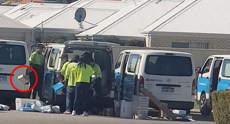 The workers were seen flinging parcels on the ground. Source: Facebook/ Michelle Shoosmith