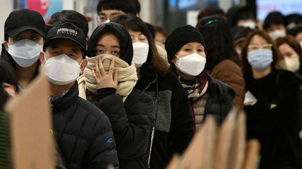 PHOTO: People wait in a line to buy face masks at a retail store in the southeastern city of Daegu on February 25, 2020. (Jung Yeon-je/AFP via Getty Images)